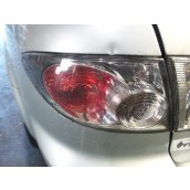 6 LH Tail Light GG/GY UPDATE SEDAN/HATCH 08/05-11/07